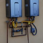 two compact tankless water heaters for more efficient hot water production