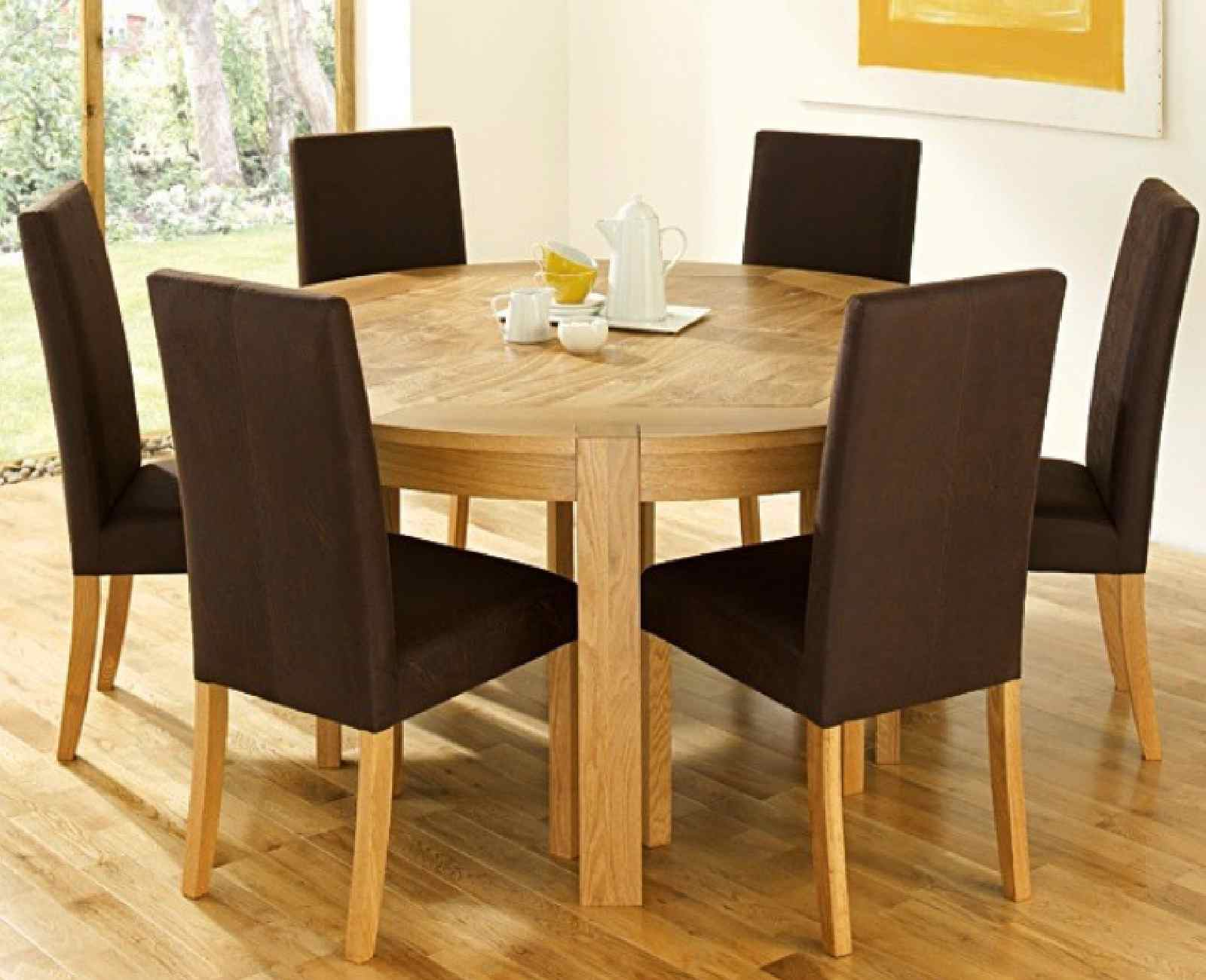 Getting a round dining room table for 6 by your own for Comedores redondos de madera