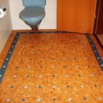 two tones blue dots cork flooring in bathroom white tile walls