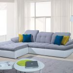 two tones modern sectional sofa sleepers with yellow blue cushions white walls soft blue round tables