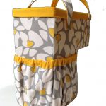 unique and playful basket design for stairs with floral patterned coat in yellow and gray combination with handle and sacks