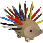 unique and playful colored pencil holder idea in porcupine shape in gray tone with colorful pencils