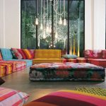 unique colorful flower huge sectional sofa colorful stripped cushion huge windows living room natural tile floor