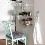 unique wall acrylic and glass makeup organizing idea with some beautiful cans for makeup tools storage with animal print chair and wallpaper and wooden floor