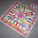 victory themed baby quilt to make design in colorful style with mosaic pattern in rectangle shape with small bag