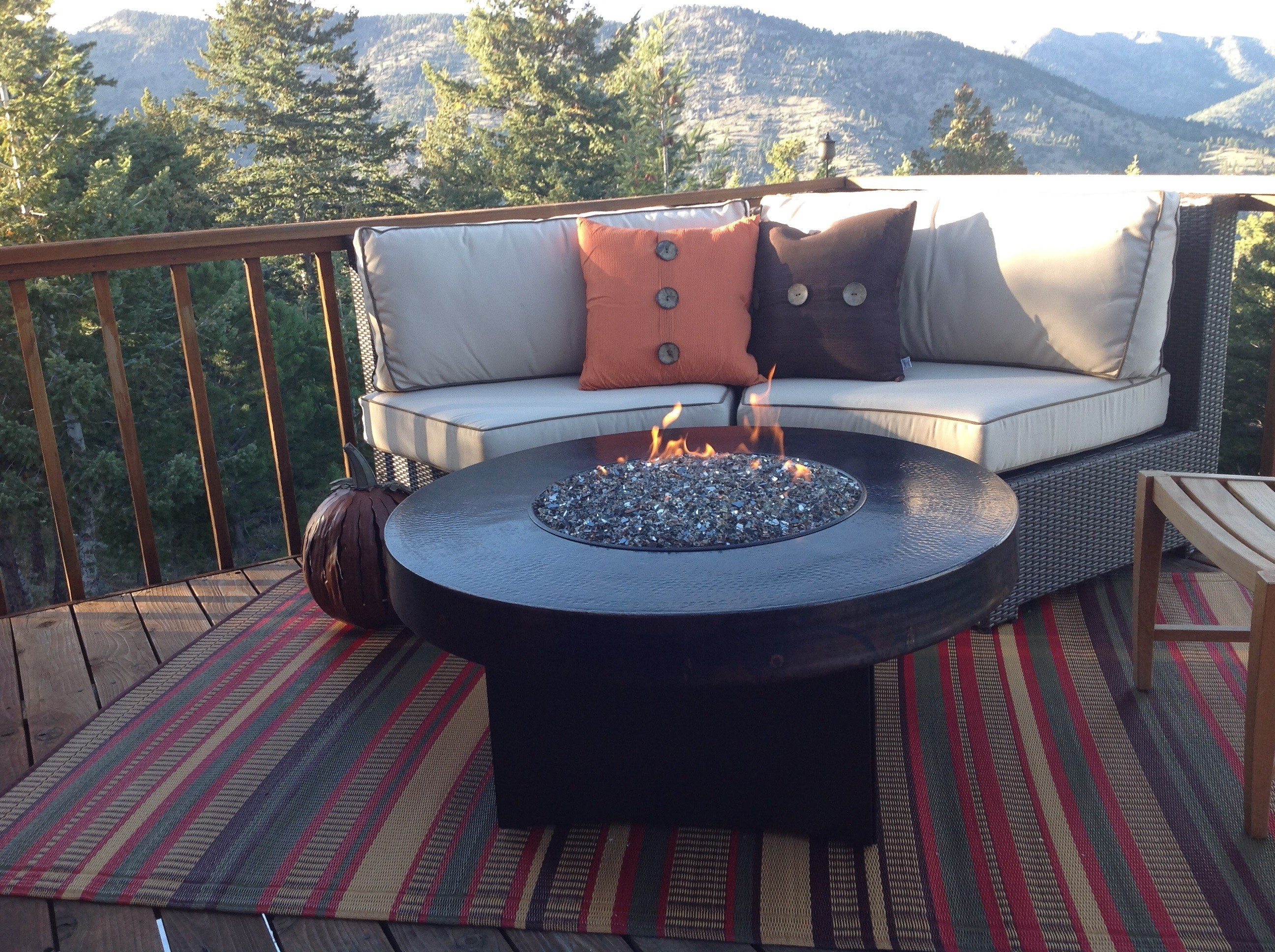 Warm Stripes Mad Mats Recycled Plastic Outdoor Rugs Wicker Sofa Orange Brown Cushions Wooden Round