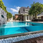 water house swimming pool rocks plants wood tree