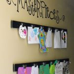 well crafted displaying kids art idea on creamy wall with black board and masterpiece letter decoration