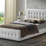 white classic twin headboard for shooting modern bedroom flower motive table lamp brown bedding gray fur rug flower wall ivory window covering