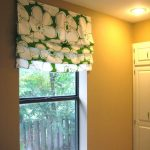 white green flower roman shades outside mount paired with romantic light for bedroom