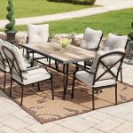 white set of walmart patio chairs idea with black wooden frame and rustic table on brown patterned area rug on paved patio