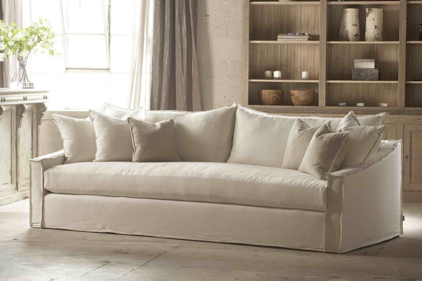 Comfortable white slipcovered sofa that brings for White divan chair