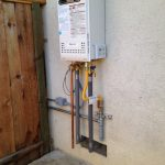 white tankless water heater wall installation backyard installation