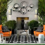 wonderful outdoor thanksgiving decoration idea with orange armchairs idea with deamond patterned area rug and cushions and wall lamps on white wall