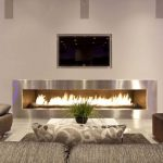 wondrous idea for tv stand with fireplace beneath and palm trees flanking before gray sofa design
