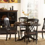 wood round table 4 chairs rug buffet