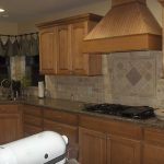 wood vent hood in modern kicthen ideas together with wooden kitchen cabinet with granite countertop and cool backsplash