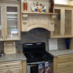 wood vent hood in modern kitchen ideas with wooden kitchen cabinets and steel gas stove and awesome countertop and great backsplash