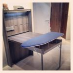 wooden fold down laundry table design with wooden board and additional navy blue iron board