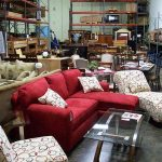 A group of used furniture such as small sectional with chaise a reclining sofa armless corner chair etc