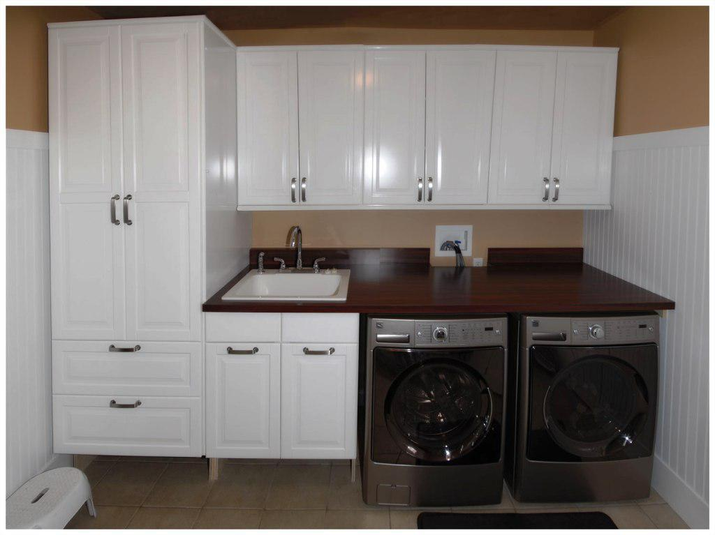A Laundry Room Cabinet System Consisting Tall Wall Series And Under Cabinets Plus Drawer