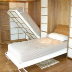 A pair of folded single bed by Murphy