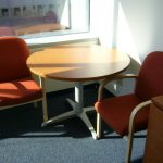 A pair of office chairs NYC and wood round table with metal base