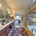 A Runner With Floral Pattern For Modern Bathroom A Built In Tub Transparent Glass Door Shower With Black Trims Large Bathroom Vanity With Large Frameless Mirror