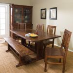A set of dining furniture in rustic and bench a hardware display cabinet with open glass door