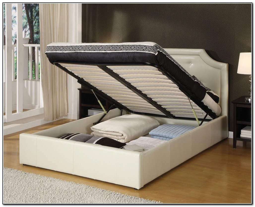 A White King Platform Bed Frame With Under Storage And Headboard