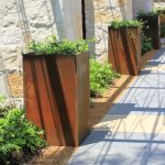 Arrangement of Corten steel box planters for outdoor