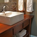 Bathroom Rustic Style With White Pegasus Vanity Tops And Sink Wooden Cabinet Towel Hanger Stone Wall