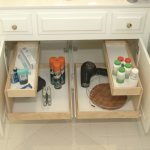 Bathroom cabinet organizer with racks inside cabinet