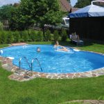 Beautiful And Fresh Swimming Pool Design Surrounding With Grass