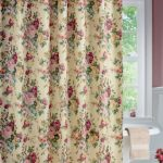 Beautiful-Vintage-Style-Victorian-Floral-Rose-Bouquet-Bathroom-Shower-Curtain-with-gold-color-on-the-top-and-white-bathtub-near-red-flowers-and-window