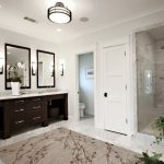 Beautiful Bathroom Rug With Floral Pattern Dark Stained Wood Bathroom Vanity With Wood Framed Mirrors Glass Door Shower Space