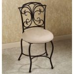 Bedroom vanity chair with white round cushion and crafted black iron structure