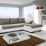 Best-couch-Furniture-2015-With-white-and-grey-color-and-glassy-table-on-brown-fur-rug-and-grey-wall