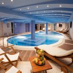 Big And Great Indoor Swimming Pool With Furniture