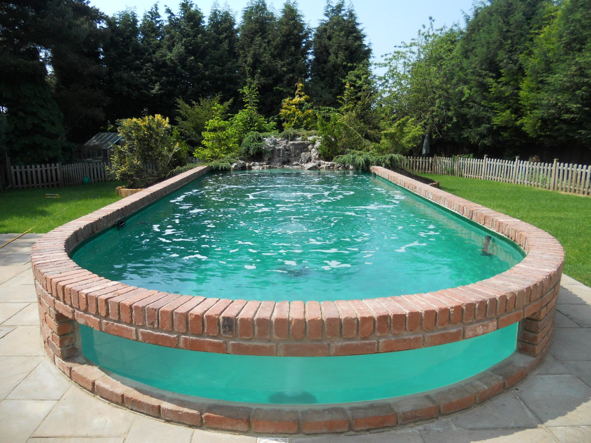 Above Ground Pools Can Come With Waterfall Features Image Source