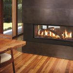 Black Wood Electric Modern Fireplace In Hardwood Floor Room With Wooden Table And Chair