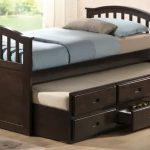 Black coated wood trundle with pull out bed headboard footboard and storage
