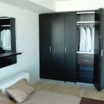Black painted wooden dresser for closet storage