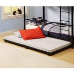 Black stained metal pull out bed frame with wheels