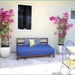 Bright blue daybed mattress with throw pillows for home exterior space