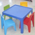 Bright blue square table with colorful chairs for kids