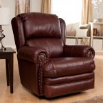 Brown Recliner With Wooden Table And Lamp In Hardwood Floor Room