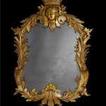 Classic looking mirror with crafted gold frame