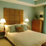 Color scheme for simple and warm bedroom decor idea which consists of light blue wall light brown free standing headboard blue window curtain corner wooden storage idea white beddding wood side table