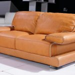 Comfy leather couch in orange with armrests